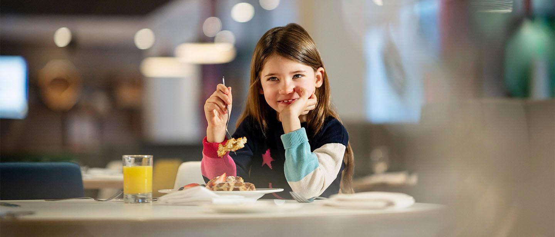 Young girl eating food