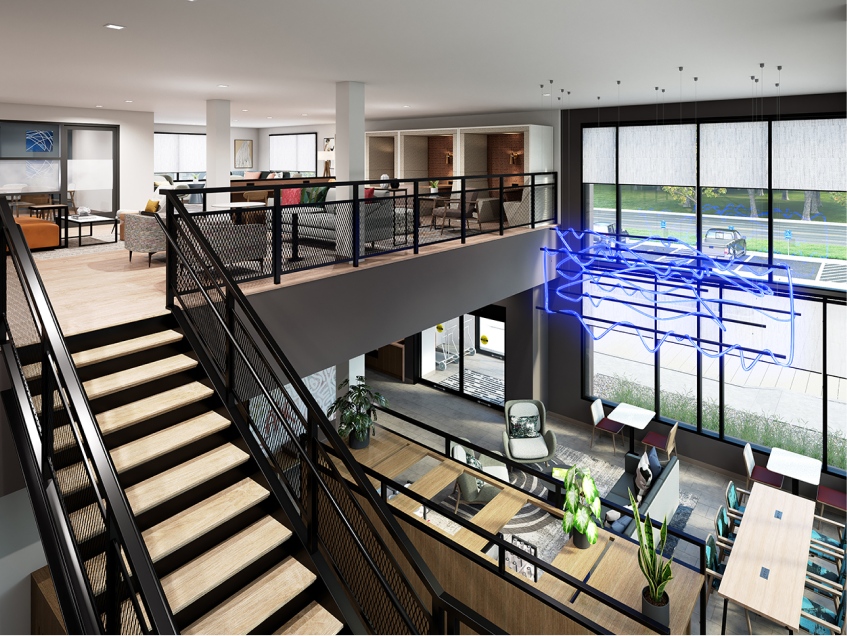 Two-storey lobby with co-working tables and booths upstairs.