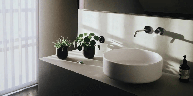 Close up of a pristine and modern bathroom washbasin.