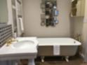 Deluxe Double – The Fuschia Four Poster bathroom