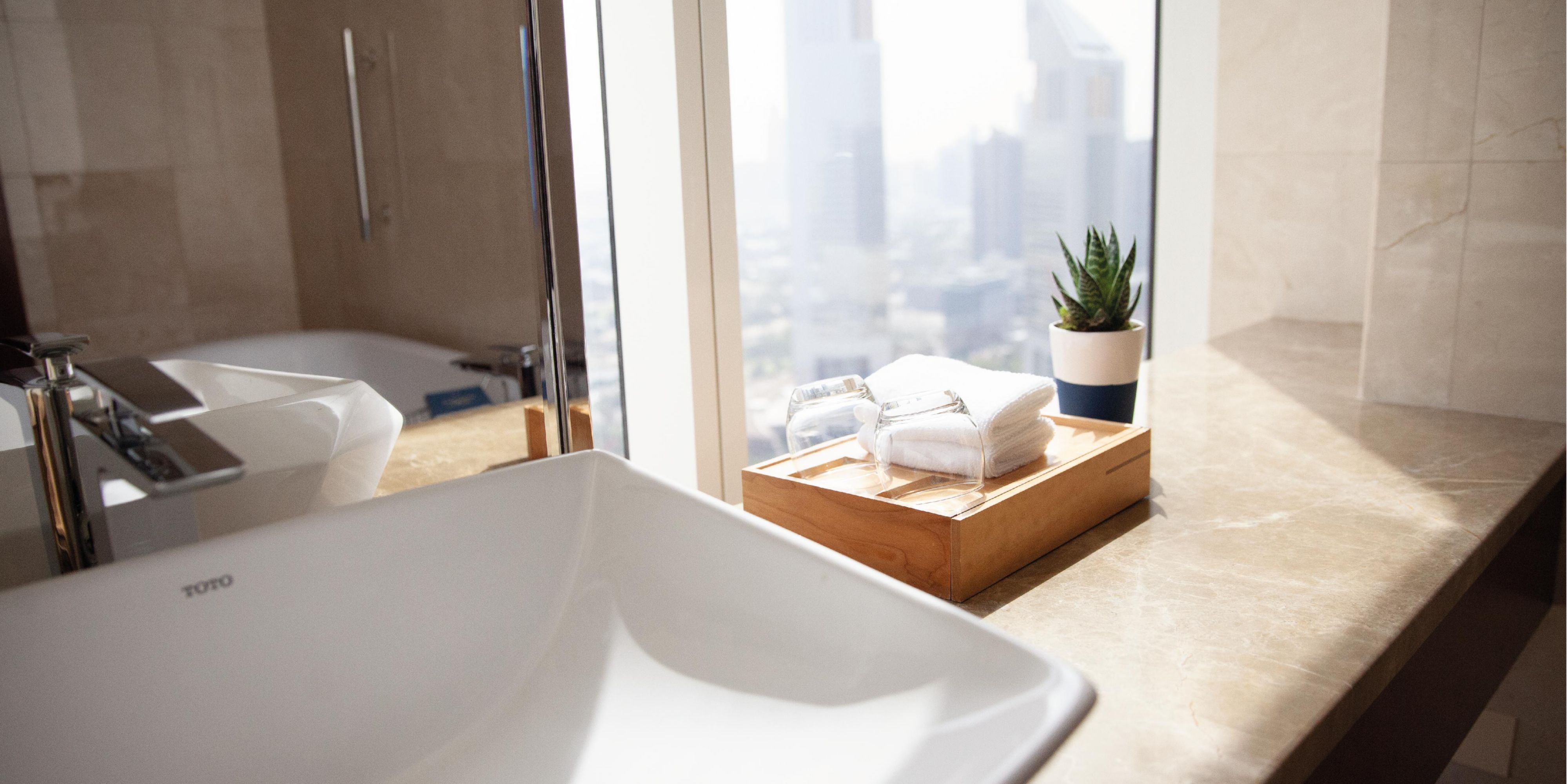 Deluxe Room bathroom, with views of Sheikh Zayed Road, Dubai