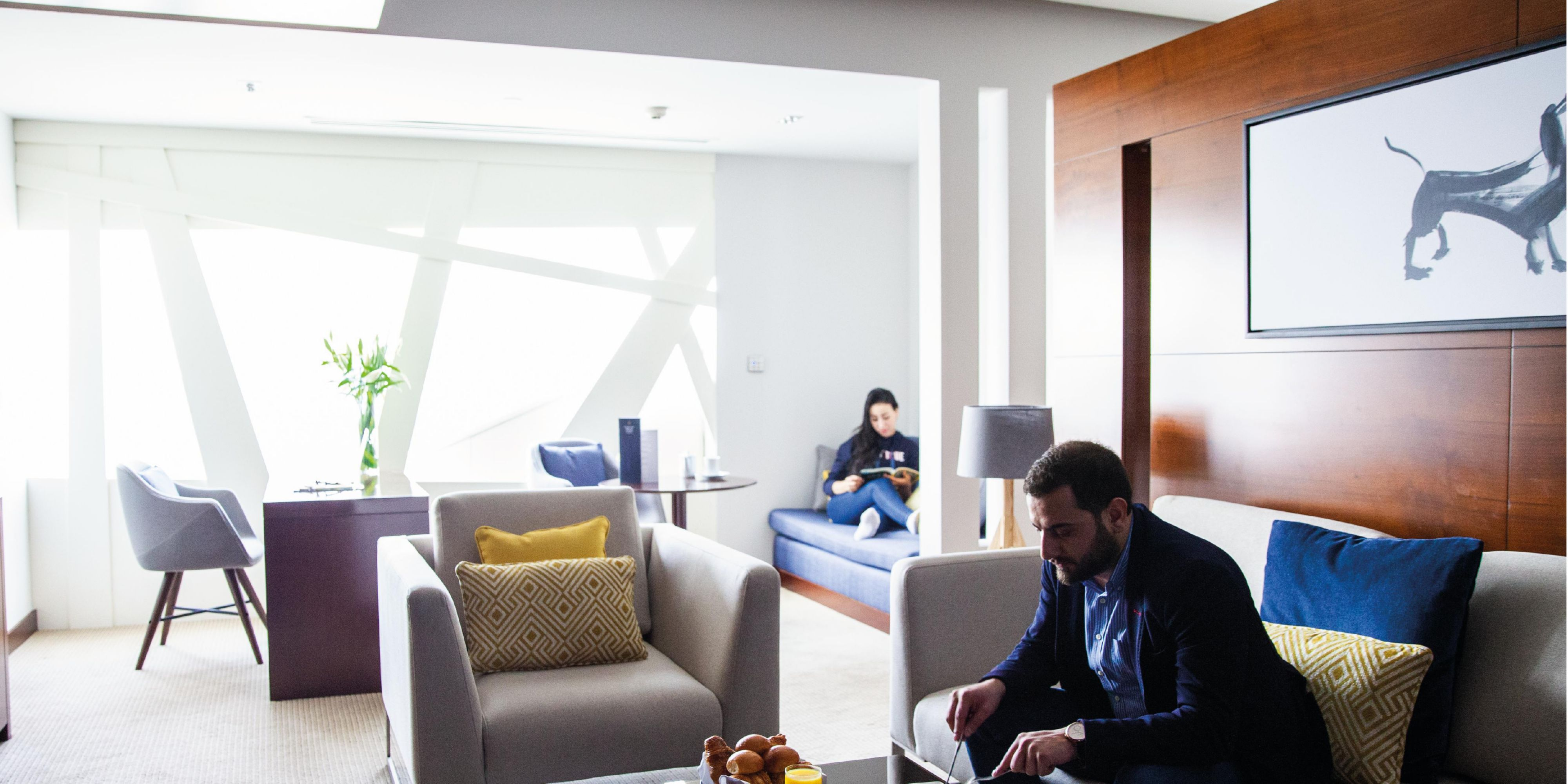 Premiere Suite bedroom, with views of Sheikh Zayed Road, Dubai