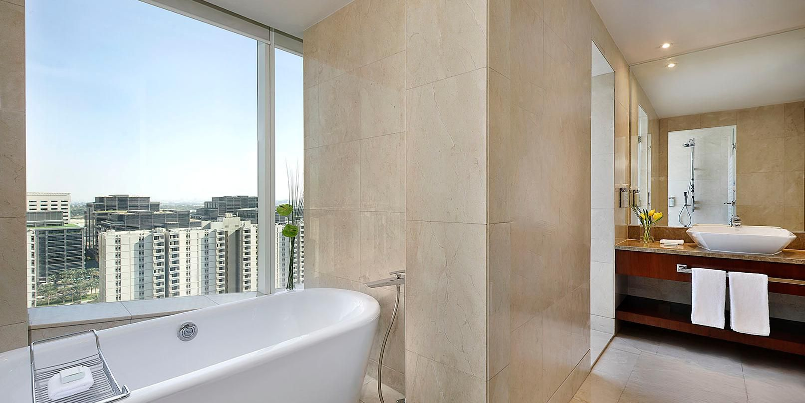 Two Bedroom Suite bathroom, with views of Sheikh Zayed Road