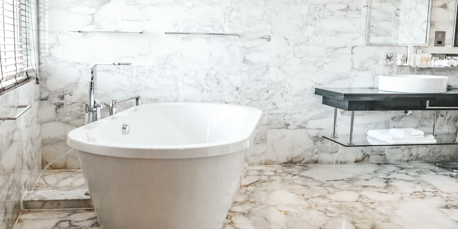 Luxurious stand alone bathtub, ready for the bubbles