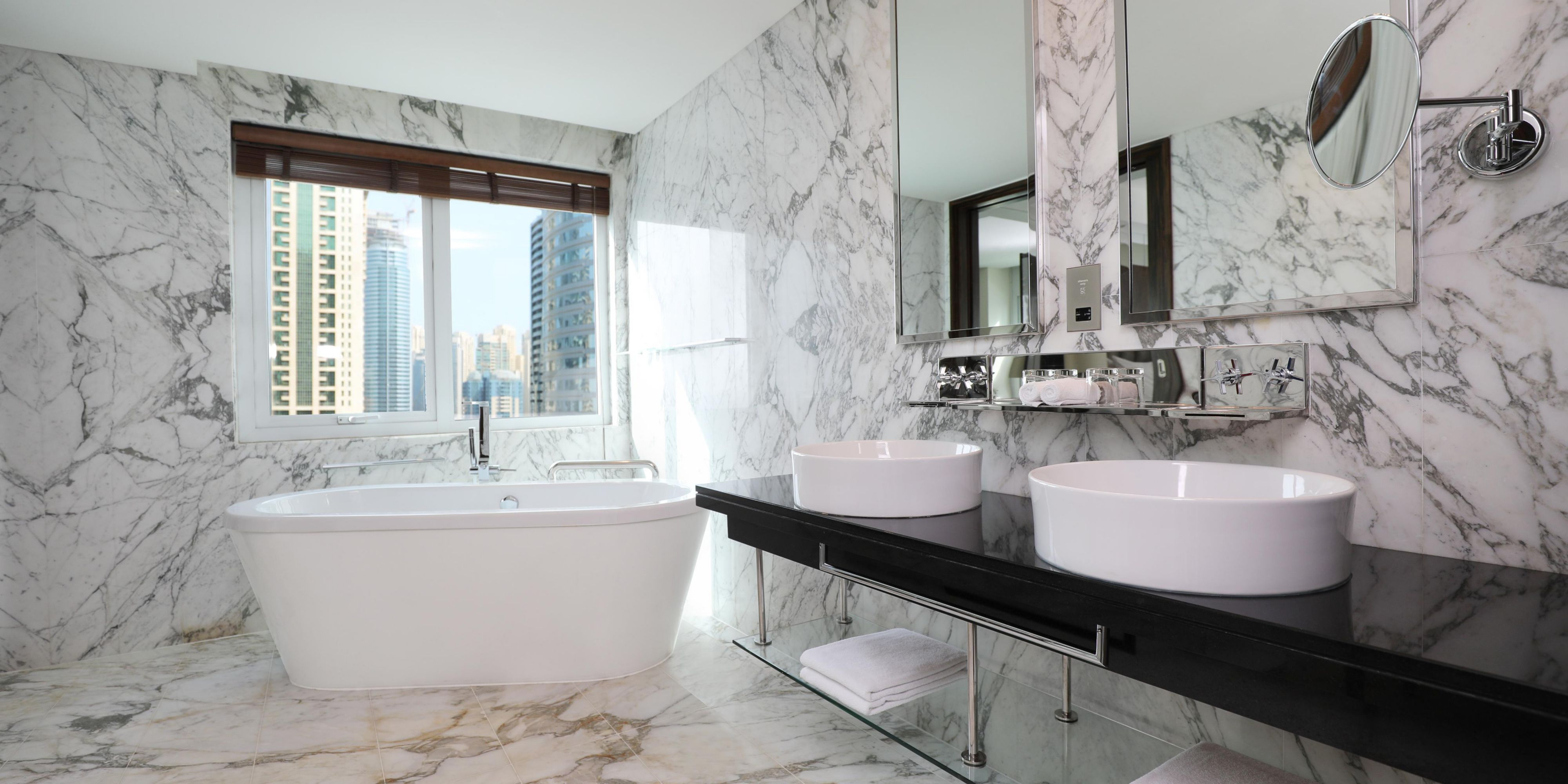 Our stand-alone bathtub and double vanity mirrors and sinks