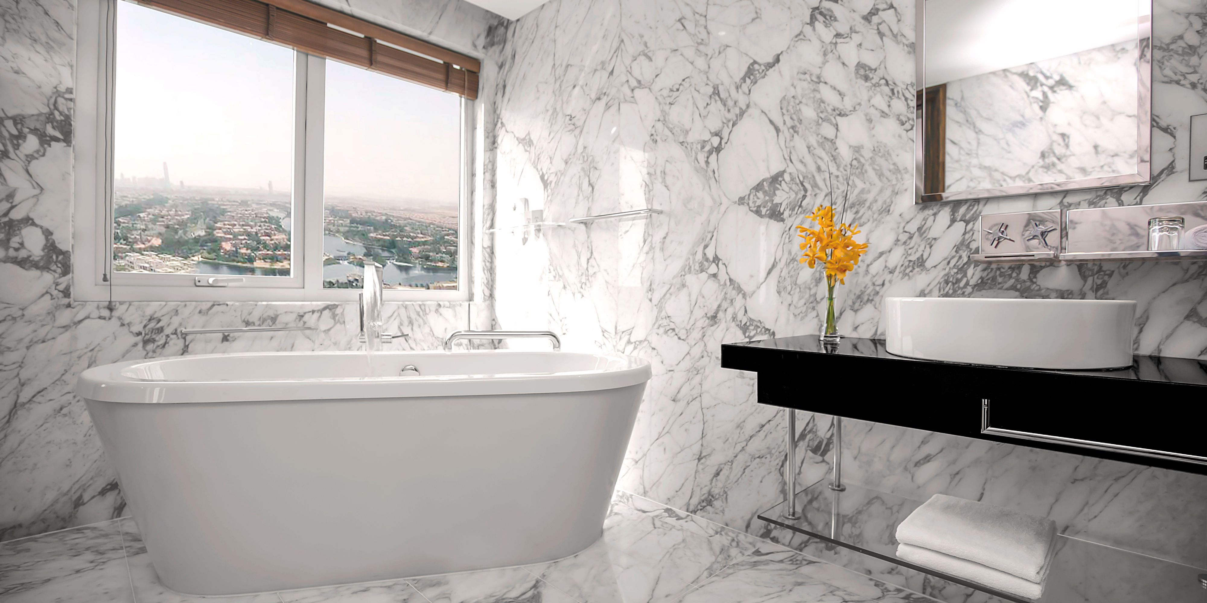Our stand-alone bathtub awaits you in our Deluxe Suite