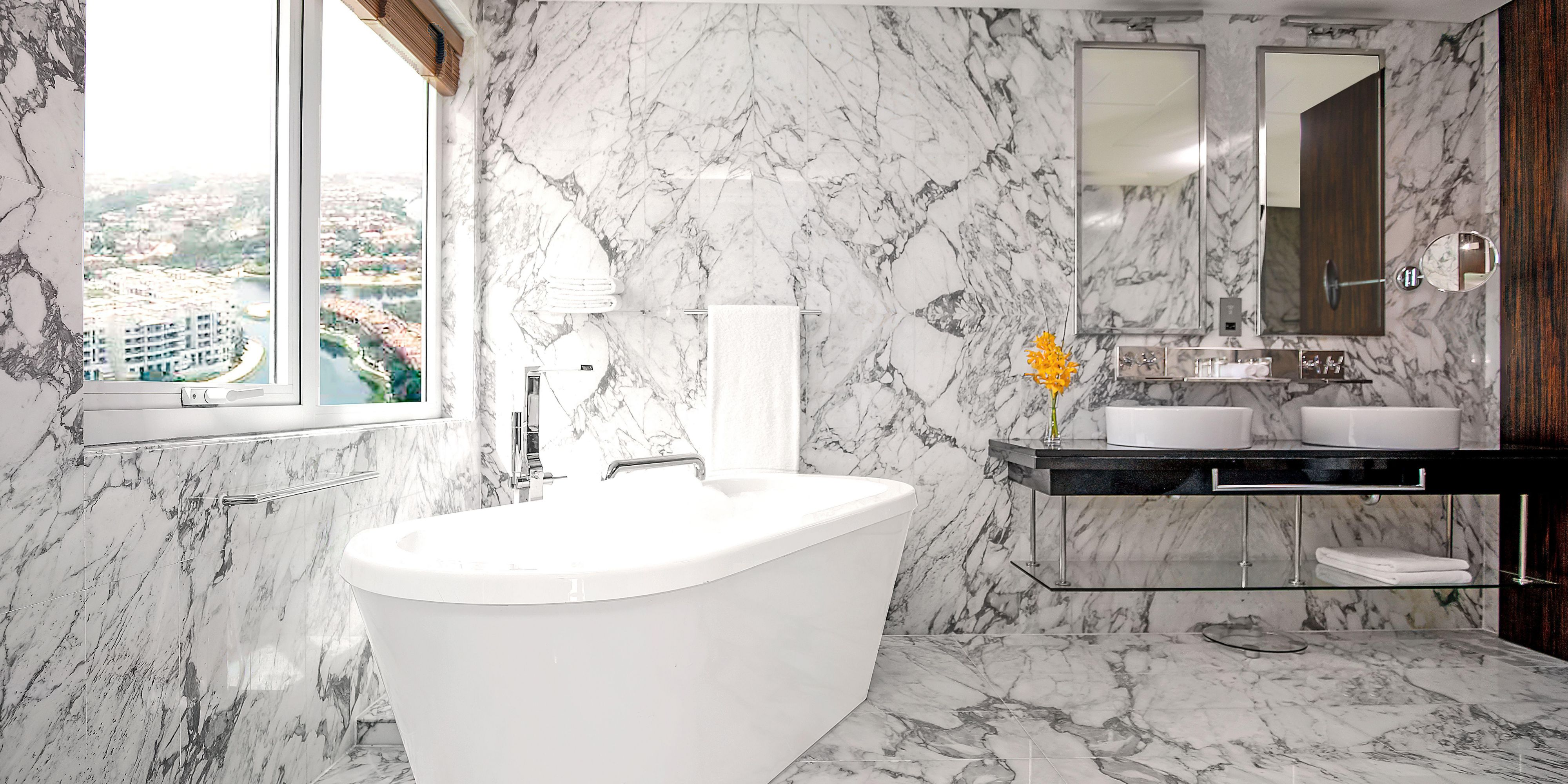 Take a soak in our luxurious stand-alone bathtub in Deluxe suite
