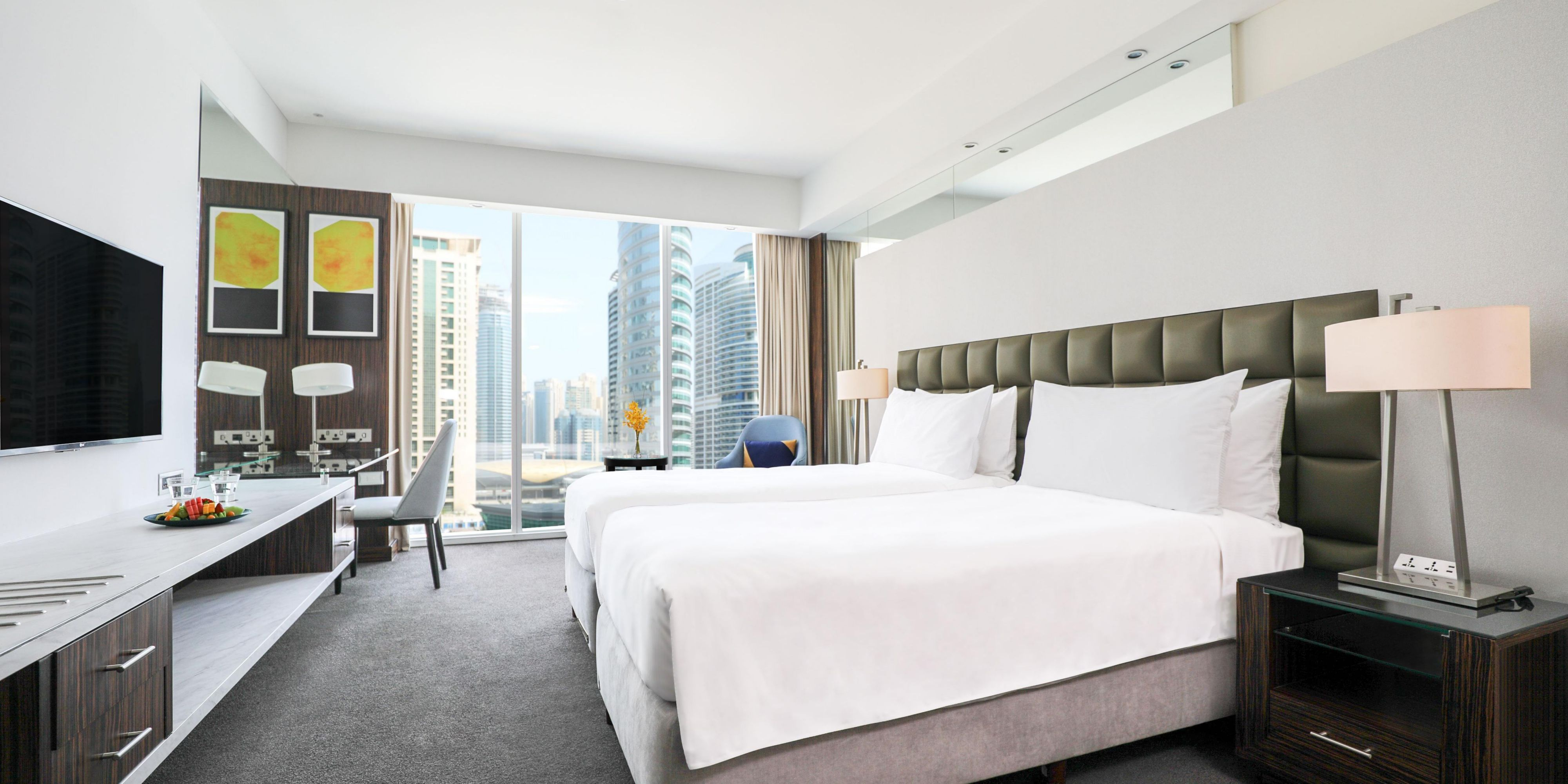 Our convenient twin beds in the Deluxe room (Almas towers view)