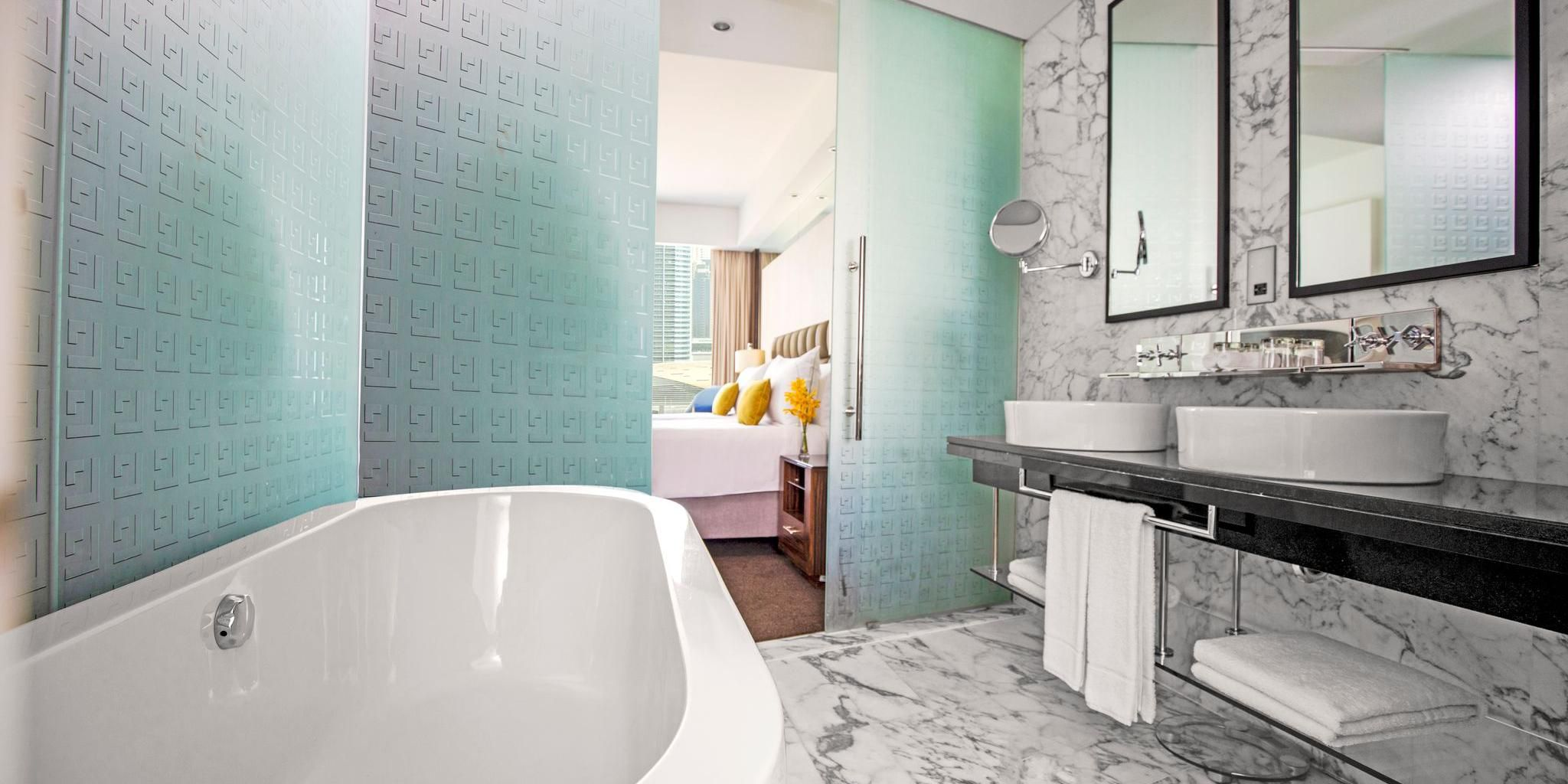 Relax and unwind in our spacious bathroom of the Deluxe room