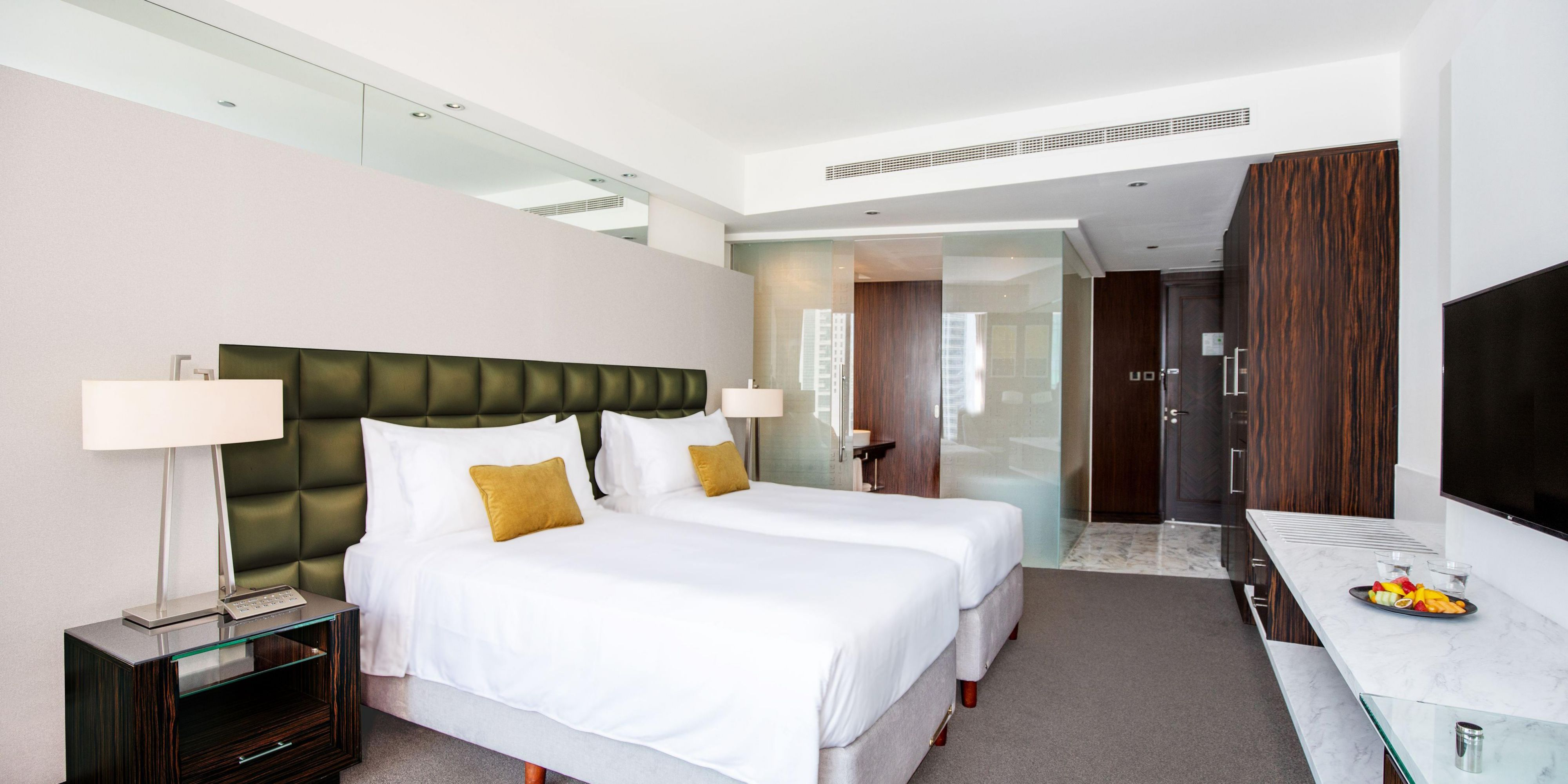Spacious and welcoming twin beds in the Deluxe room