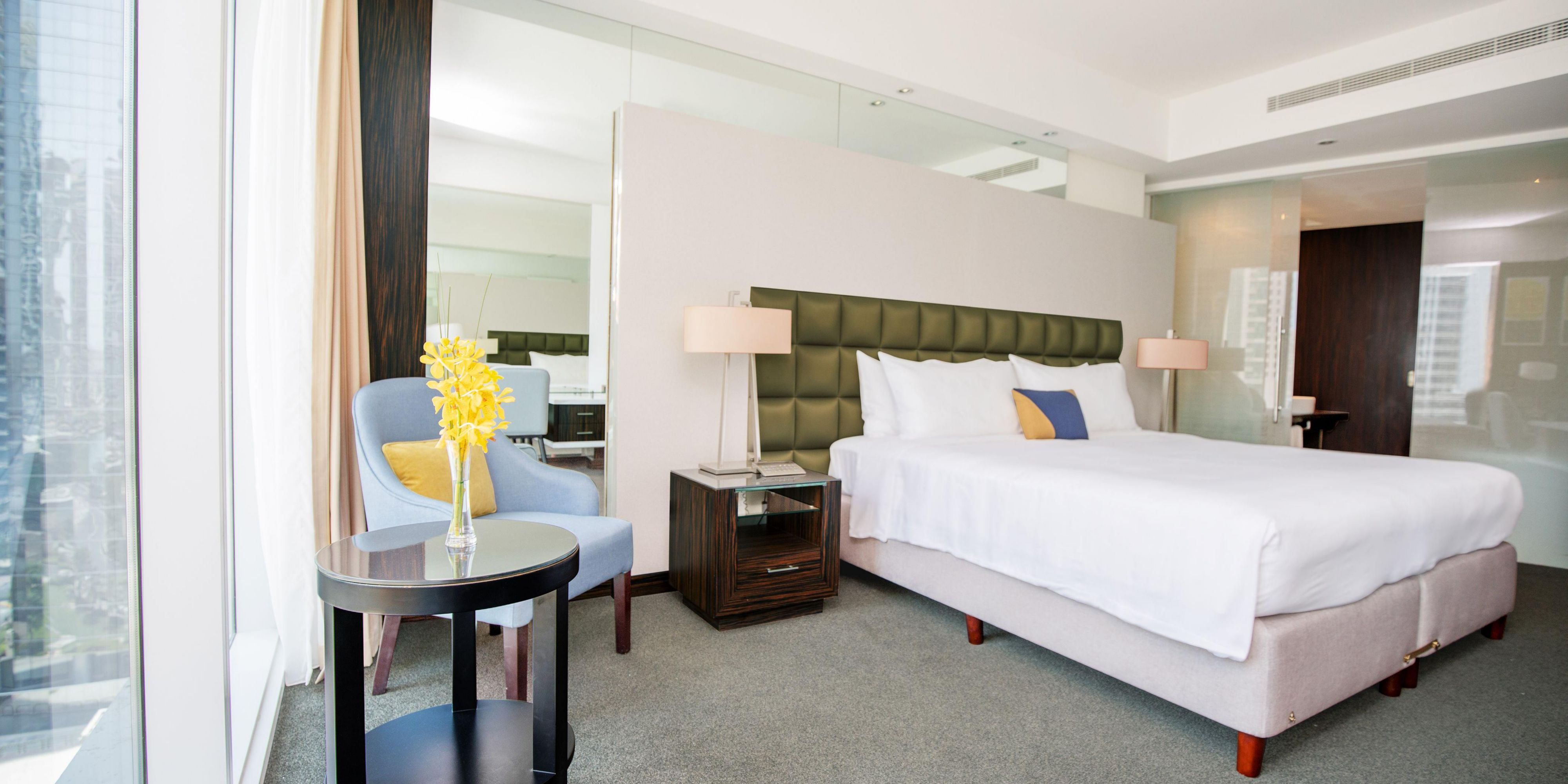Spacious room and inviting king size bed in our Deluxe room