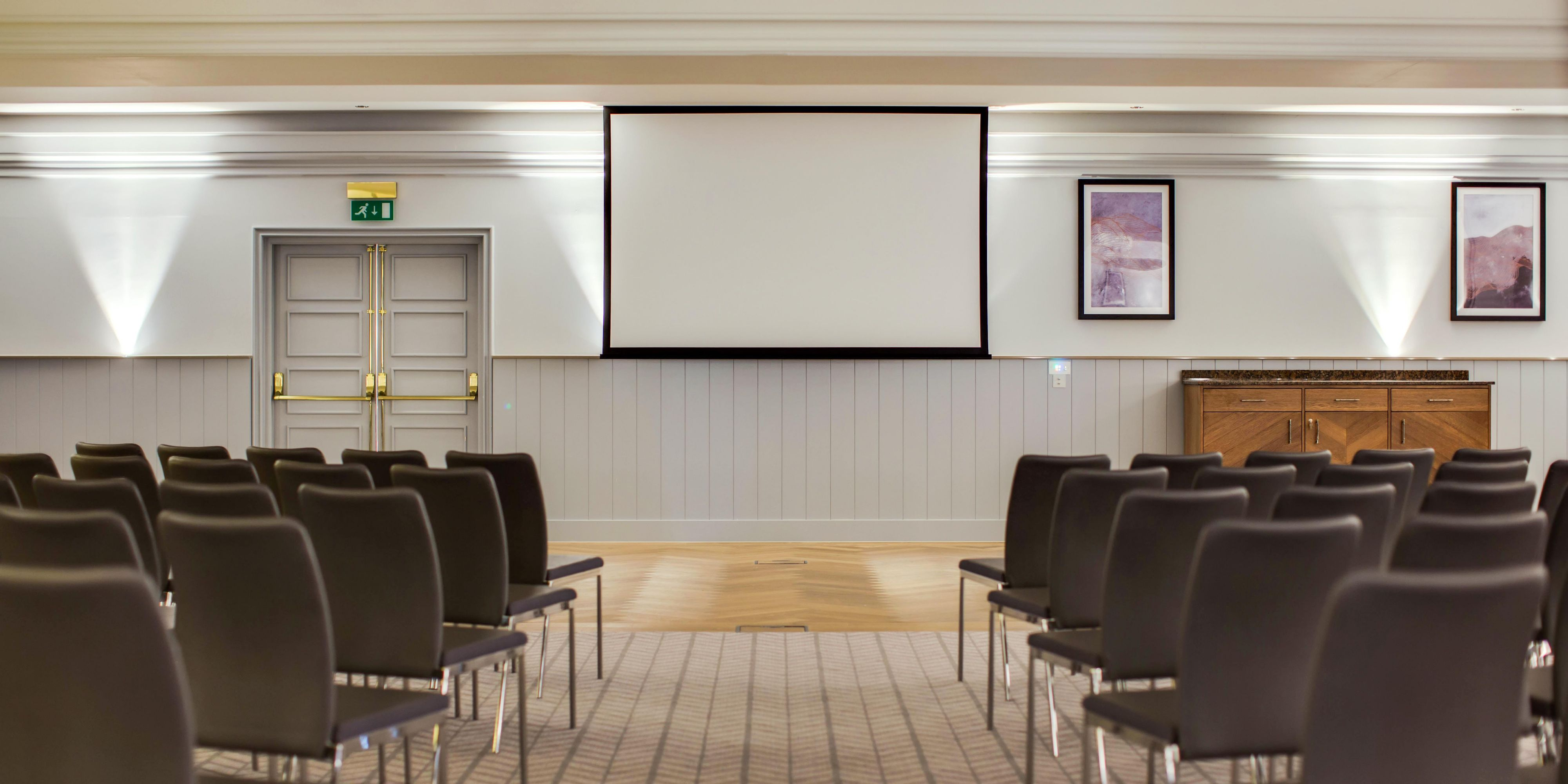 The Victoria set theatre style for a meeting with built in AV