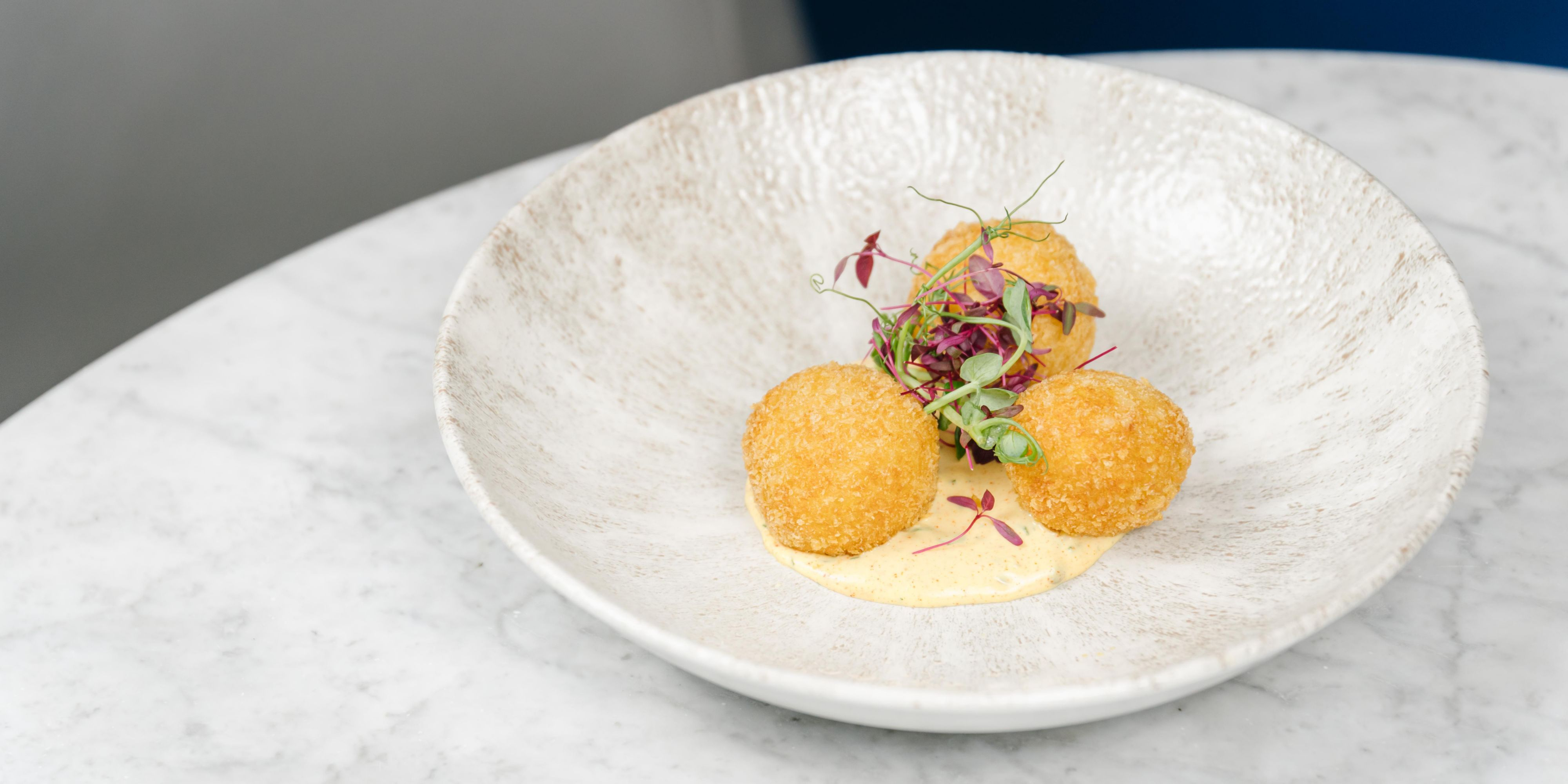 Enjoy a touch of Italian with our roasted squash arancini