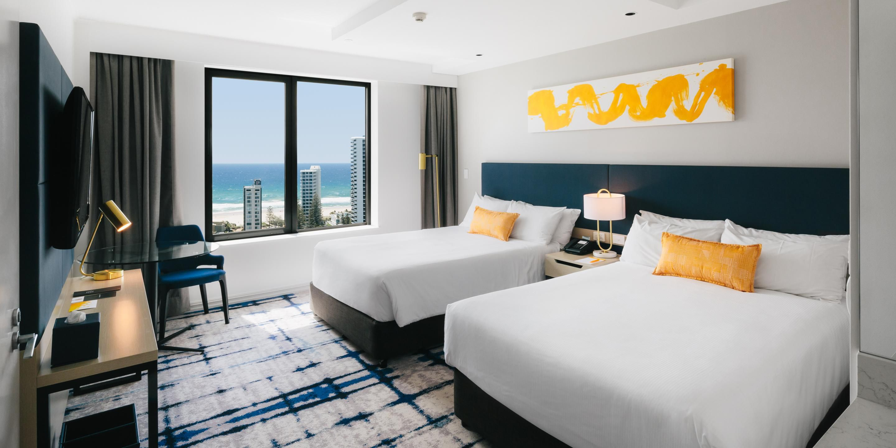 Deluxe room twin beds with Pacific ocean views