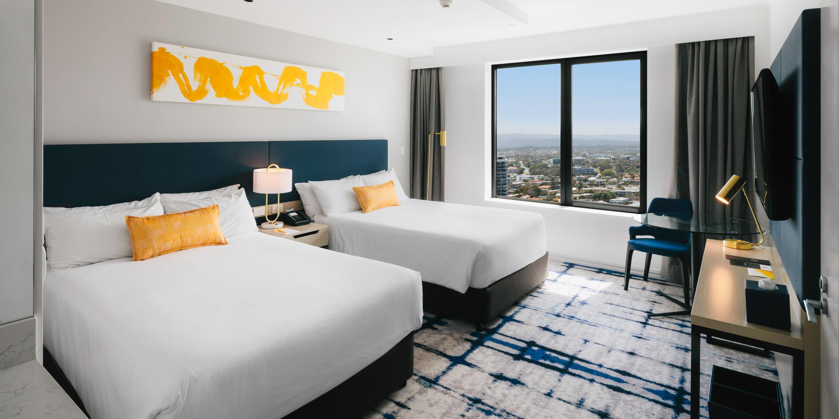 Deluxe room twin beds with hinterland view