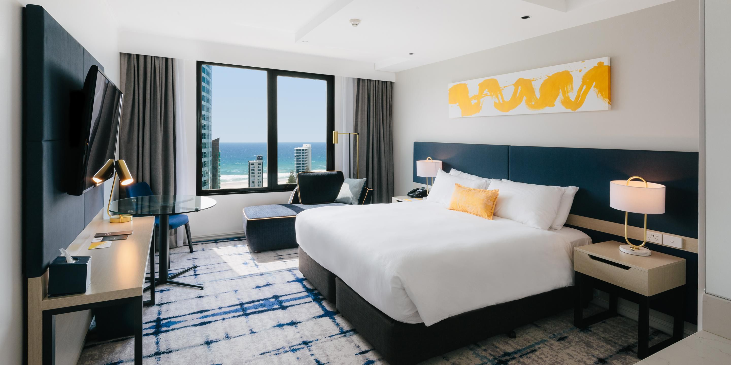 Deluxe room king bed with Pacific ocean views