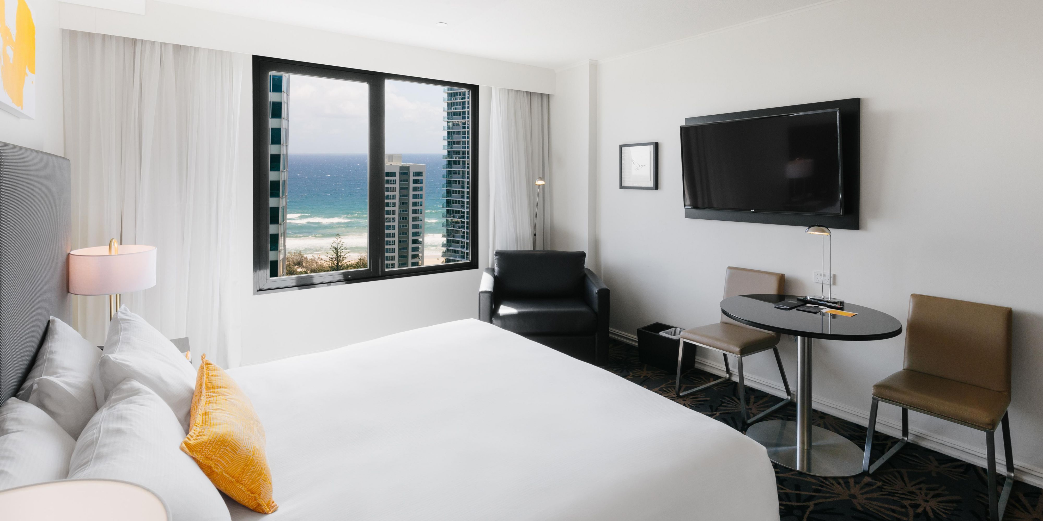Glimpse the Pacific ocean within the comfort of your Superior room